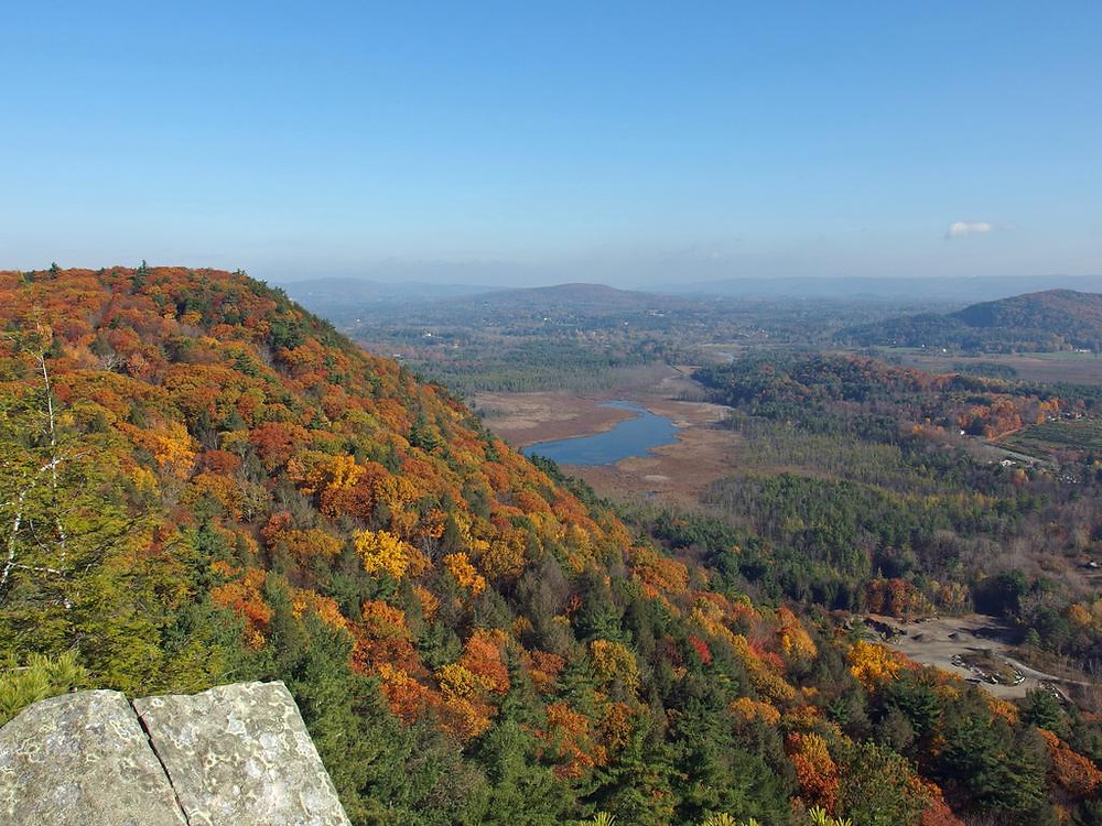 Northern view from the precipitous edge of Squaw Peak looking over the shoulder of Monument Mountain in western Massachusetts with late-October color