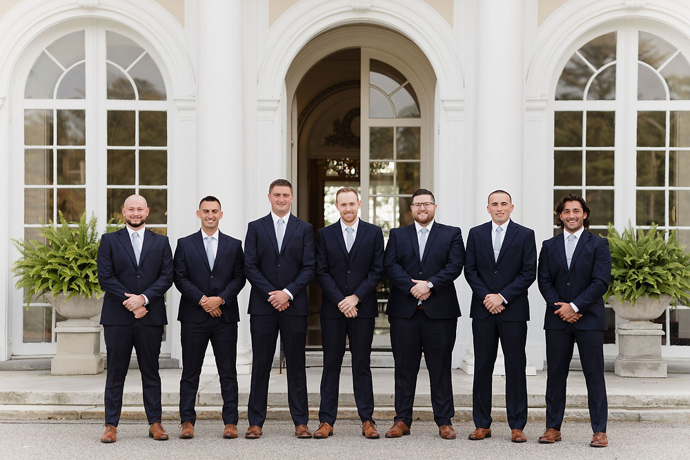 groomsmen photo outside front entrance of Tupper Manor