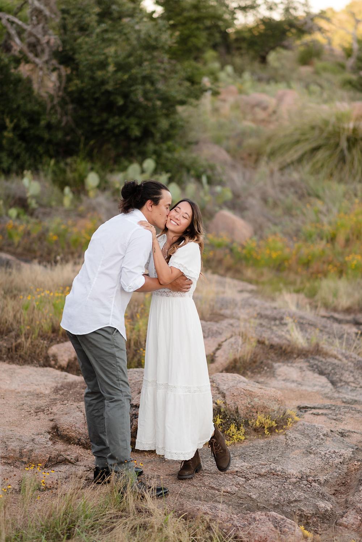 guy kissing girl on cheek