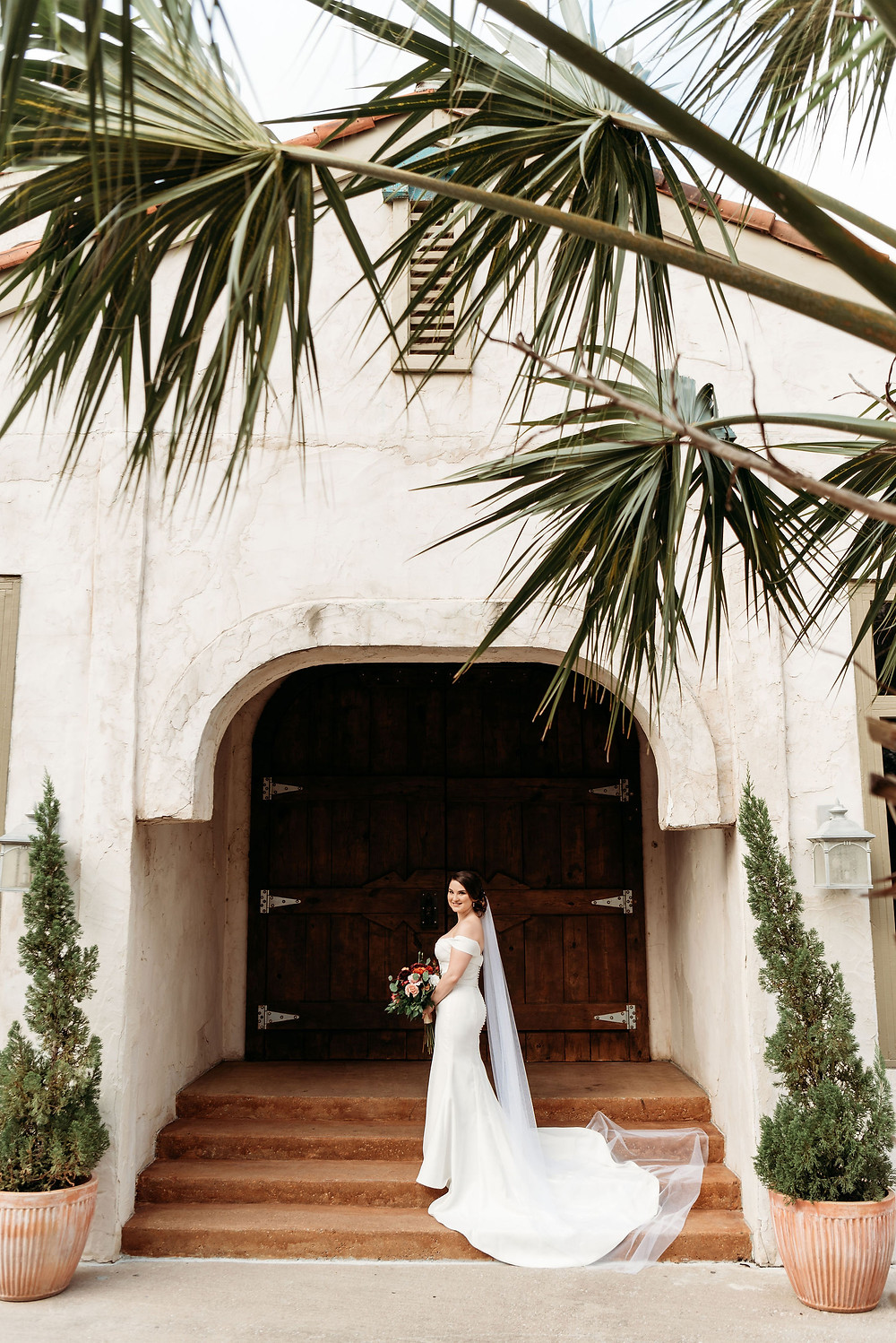 bridal portrait in front of wooden chapel doors at villa antonia