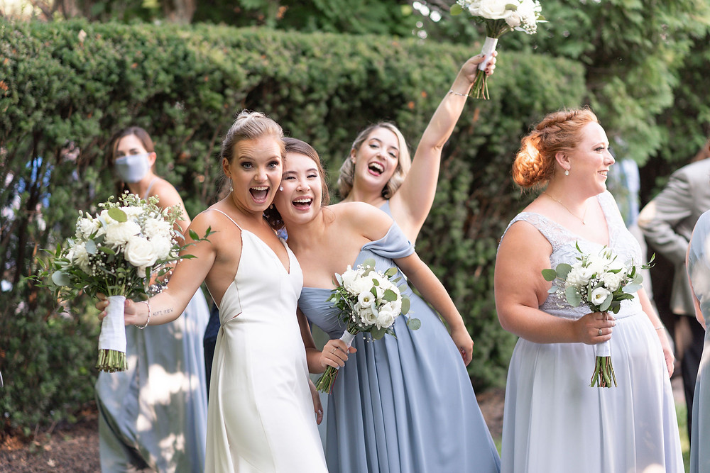 bridesmaids celebrate after wedding