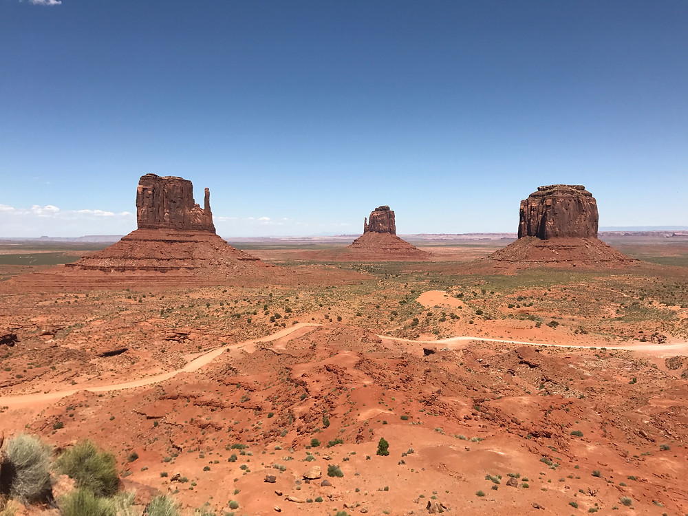 view of the three famous sandstone buttes in momument valley in Arizona