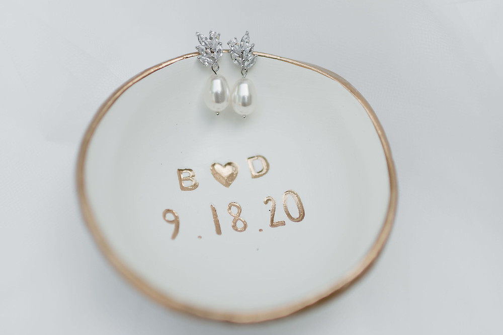 earrings on personalized wedding ring dish