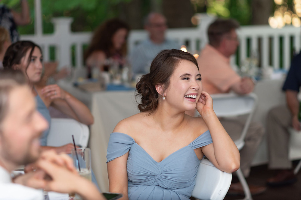 bridesmaid laughing at wedding reception