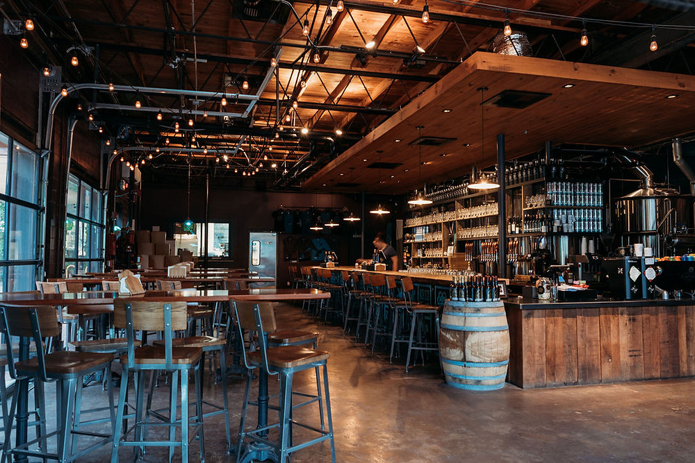 Elopement at Lazarus brewery in Austin. Inside of Lazarus Brewery showing the rustic bar and Edison lightbulbs in bar