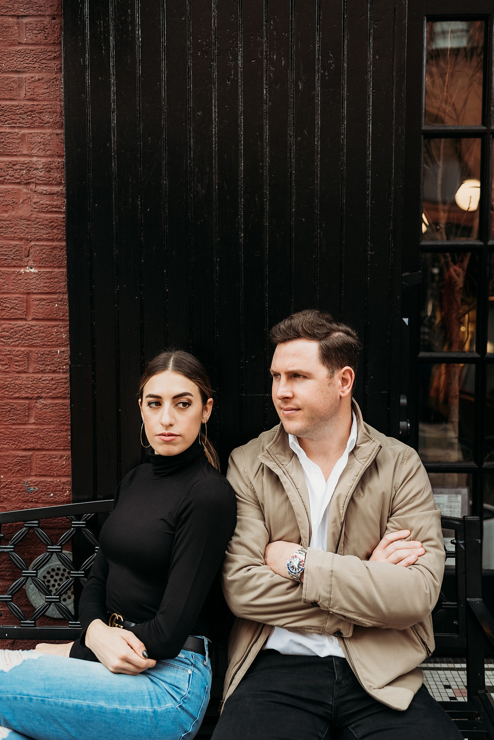 serious photo of couple outside bagel shop in NYC