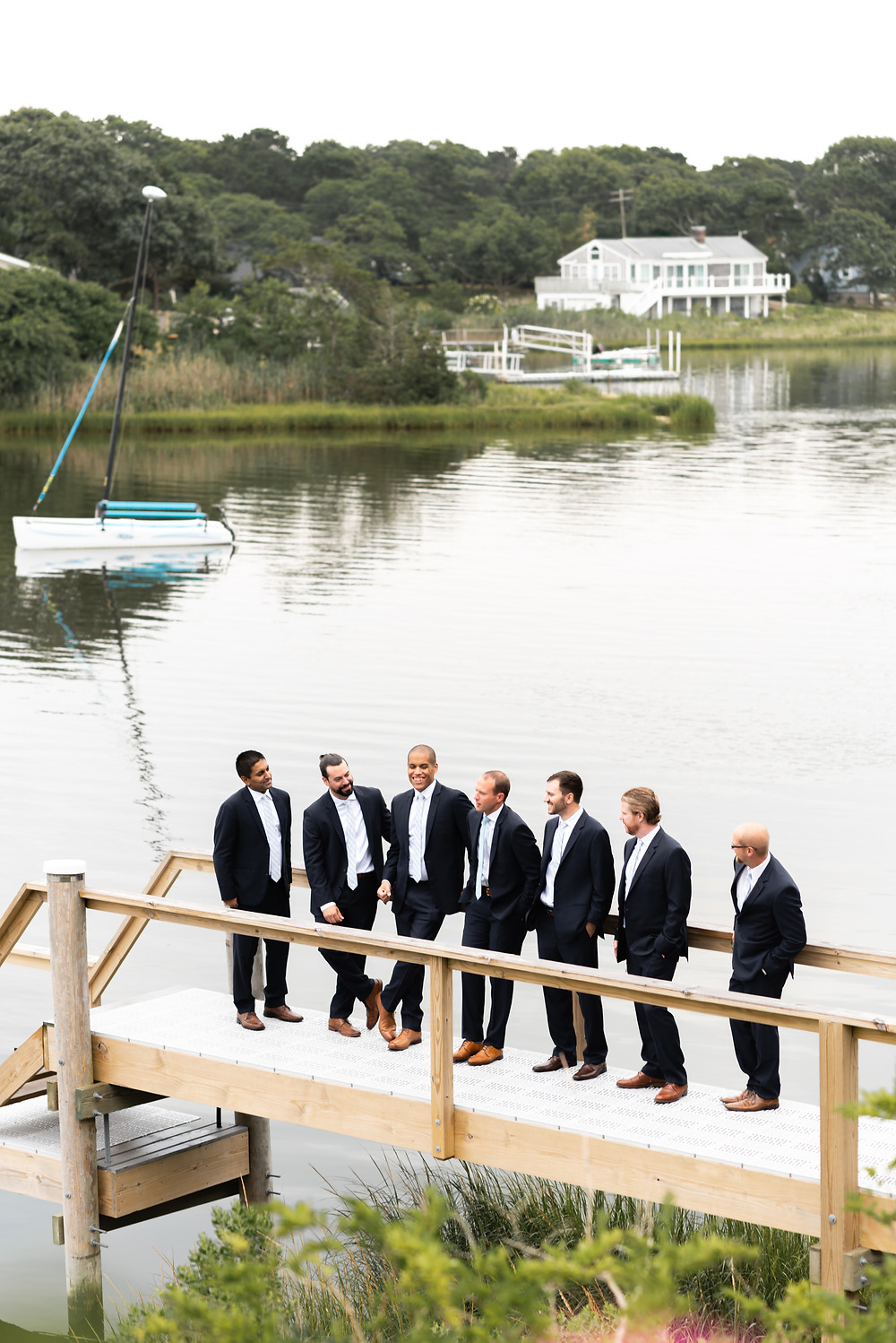 groomsmen portrait on dock in cape cod