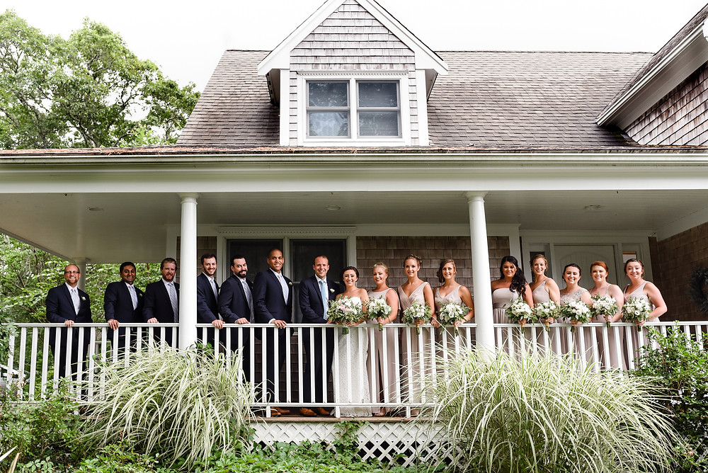 wedding party photo on dock of house in cape cod