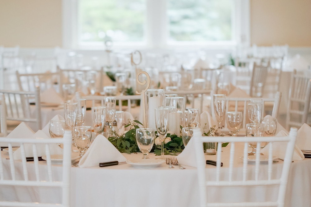 white and greenery tablescape for wedding at brookside country club
