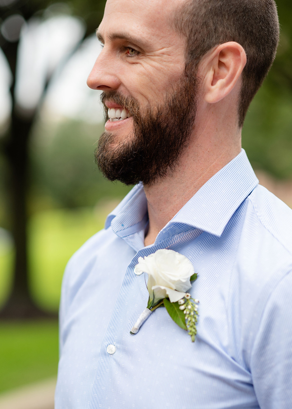 groom in front of austin capitol building for elopement