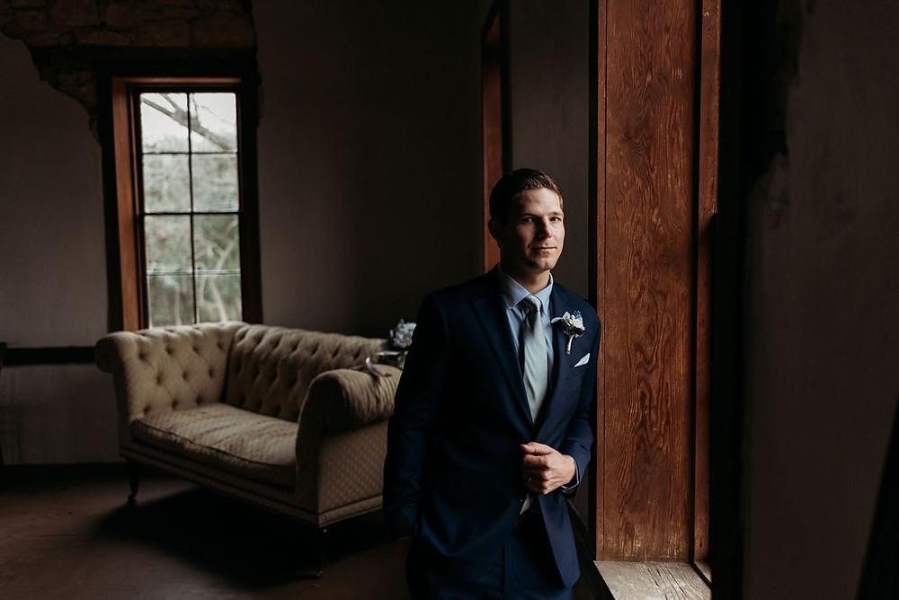 groom portrait moody light