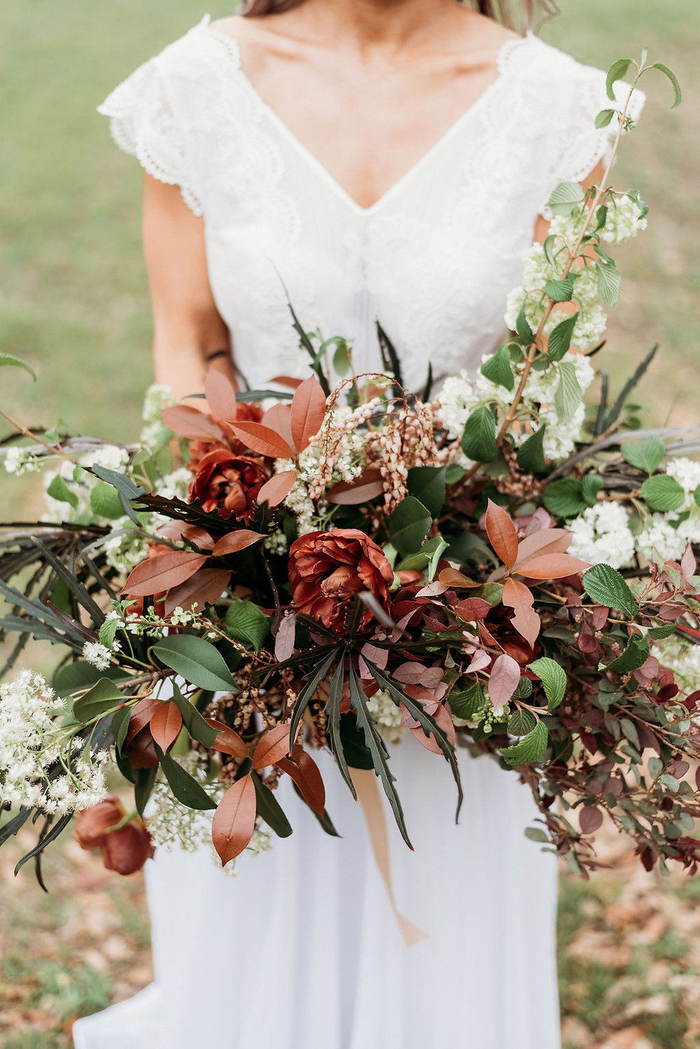 bridal portrait with her bridal bouquet from wow factor floral for her Austin elopement. you cannot see bride's face.