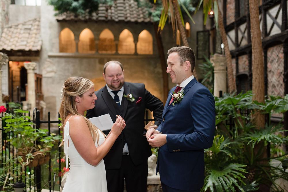 bride examines groom's wedding ring before ring exchange