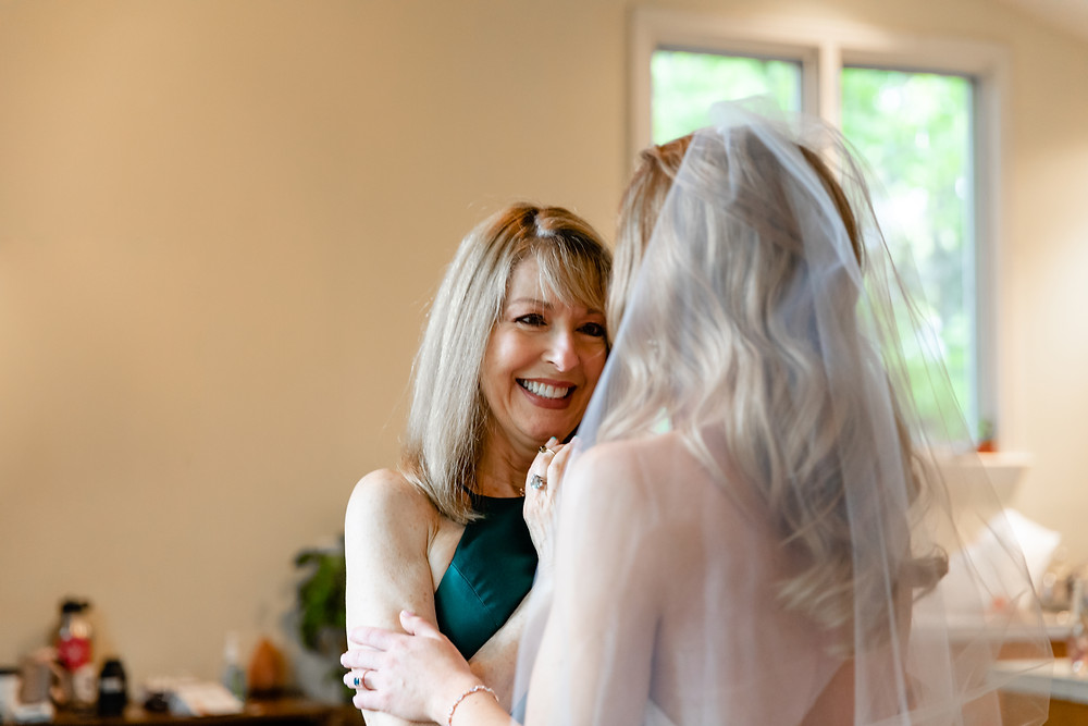 mom looking lovingly at bride