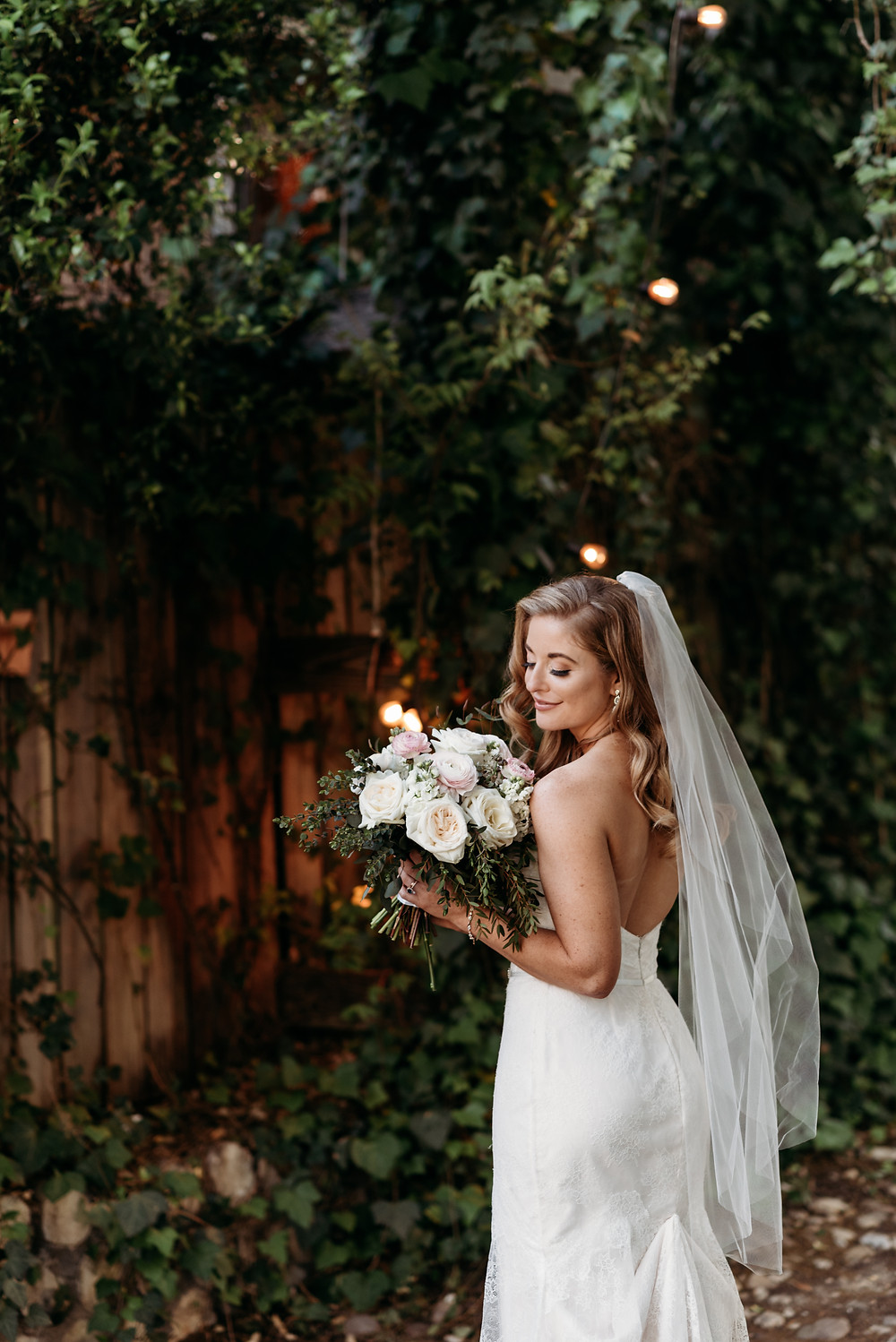 bridal portrait of bride in wedding dress with her boquet