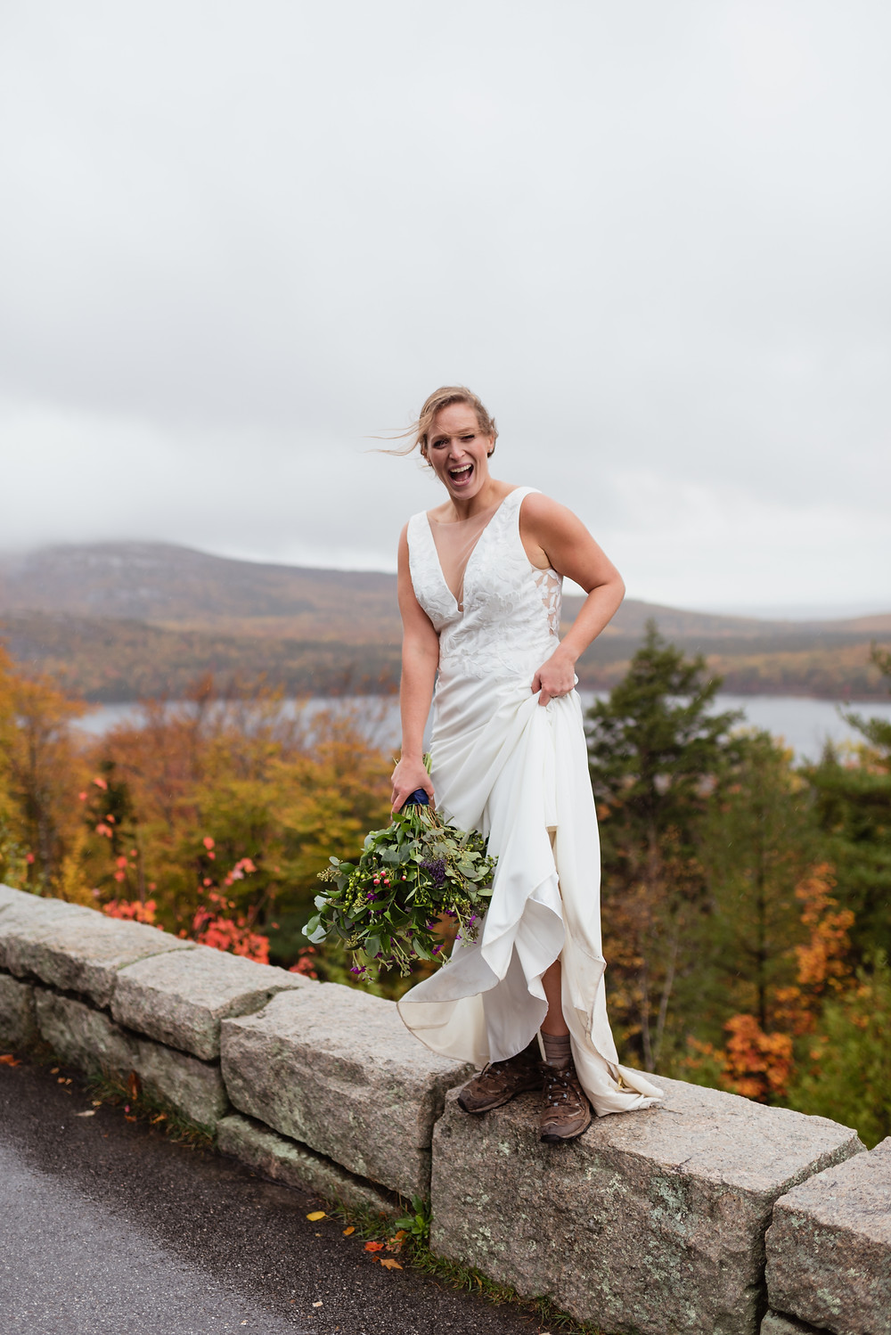 bride standing on side of road showing off her hiking boots