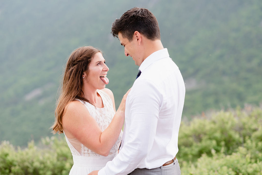 bride sticking tongue out at groom being silly during wedding ceremony