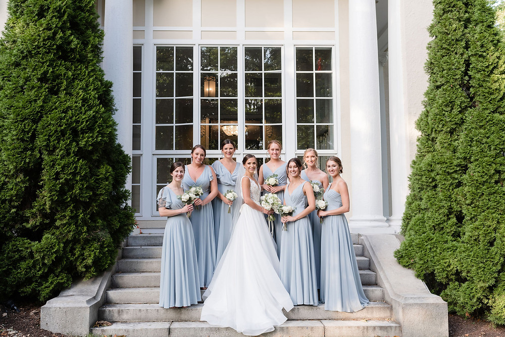 bridesmaids photo on the back steps behind Tupper Manor off of the reception area