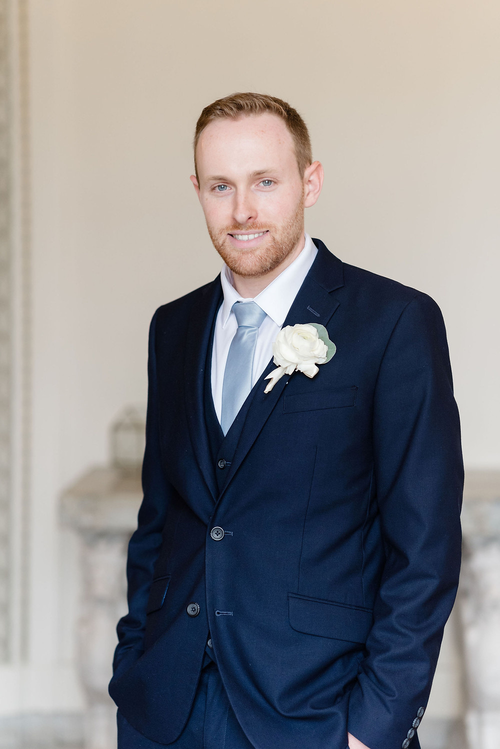 photo of groom looking at the camera