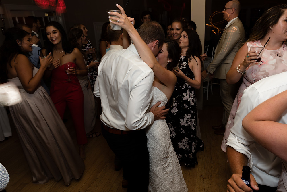 candid photo of couple dancing at wedding at brookside country club