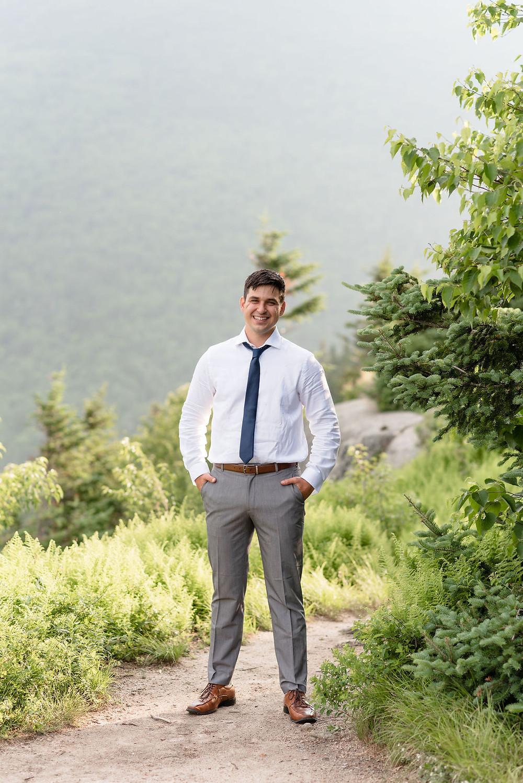 groom's portrait on top of mountain