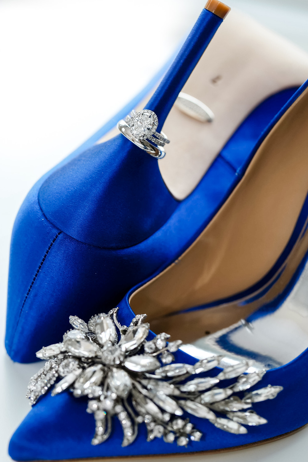 wedding rings on heel of Badgley Mischka wedding shoes