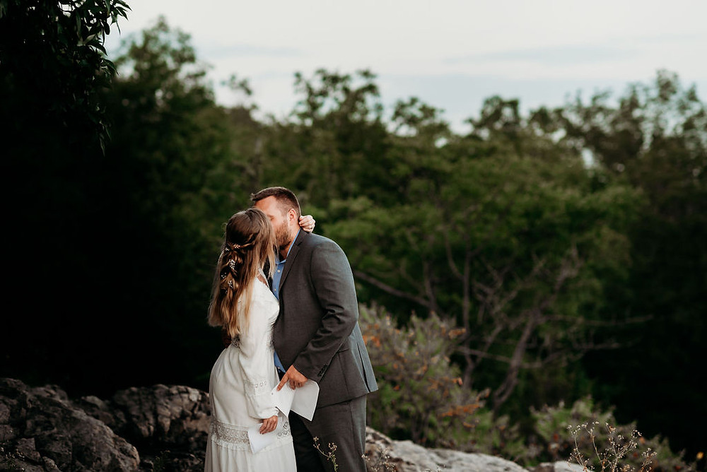bride and groom's first kiss during their adventure elopement