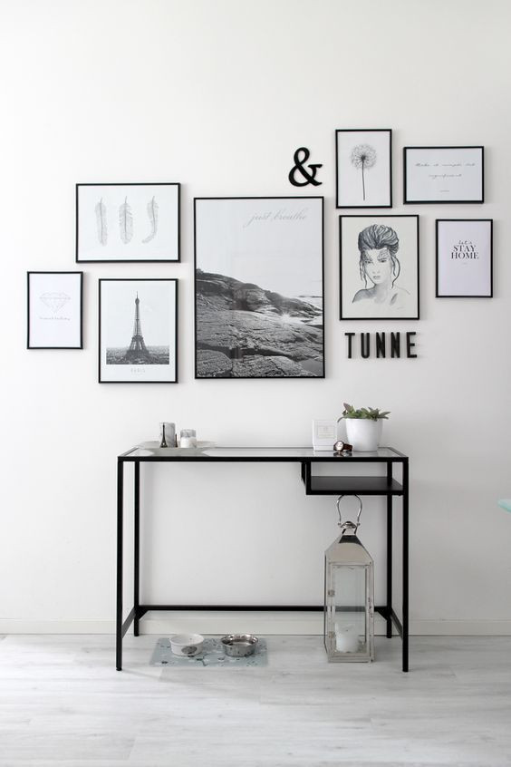 black and white assortment of prints, frames, and decor
