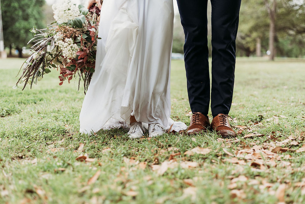 photo of the bride and groom standing next to each other during their Austin elopement. the photo is only of the bride and groom's legs and shoes. you cannot see their faces