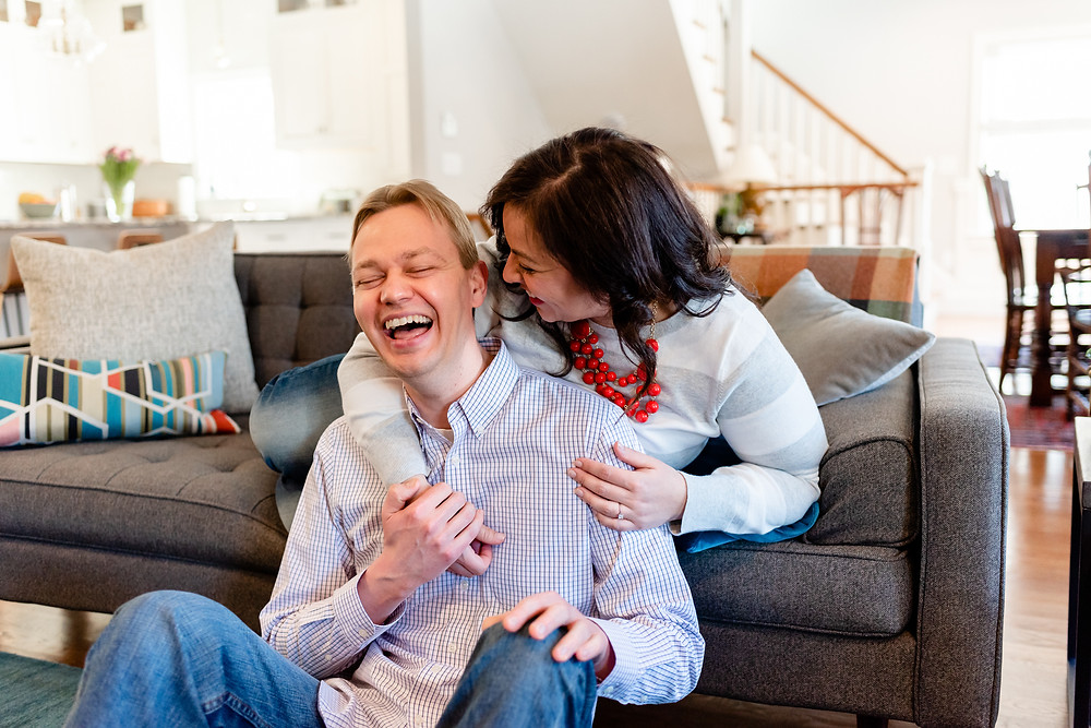 in-home session posed on the couch with real laughter