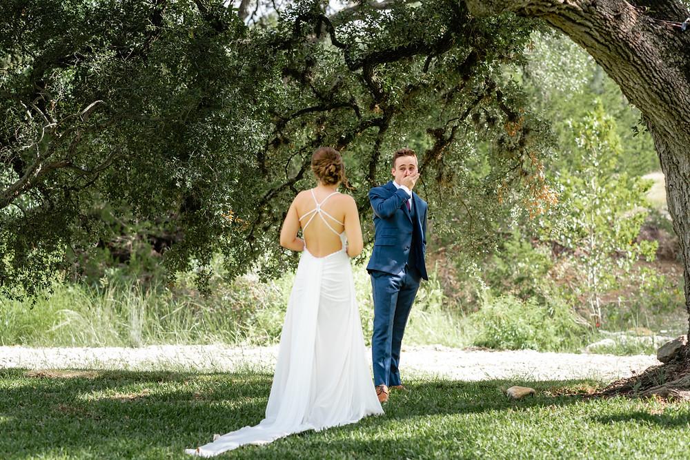 bride and groom first look before wedding at pecan springs ranch