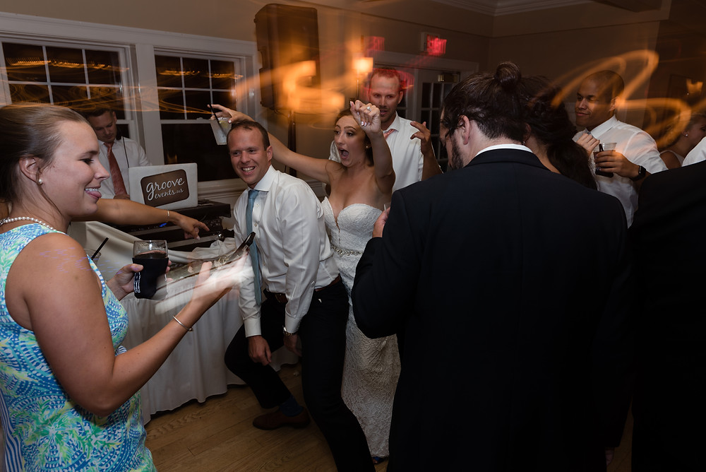 candid photo of couple at wedding at brookside country club