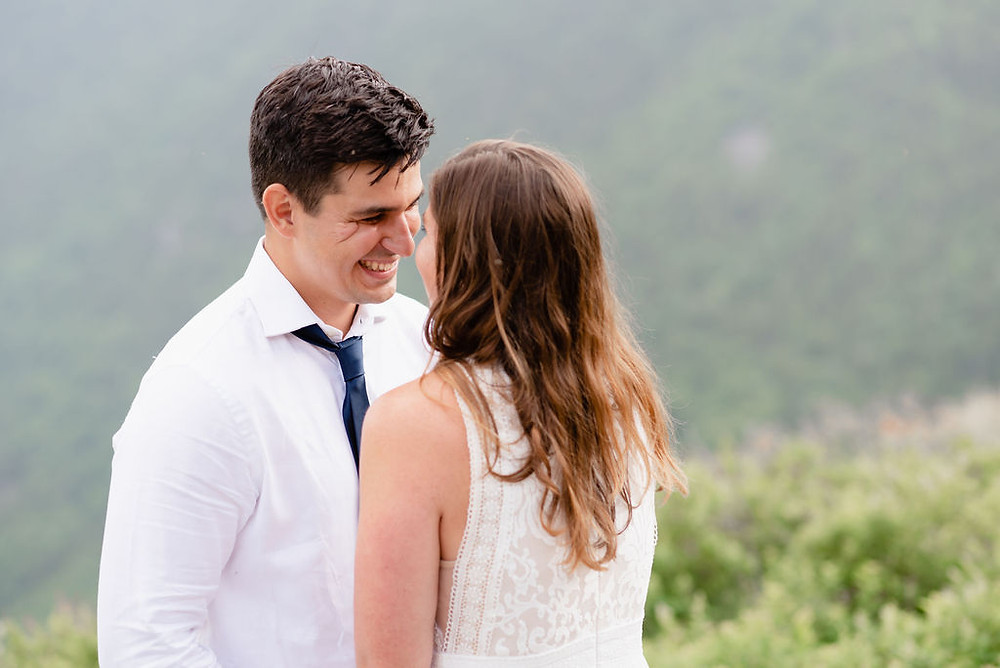 a close up photo of the groom smiling at the bride during their elopement ceremony