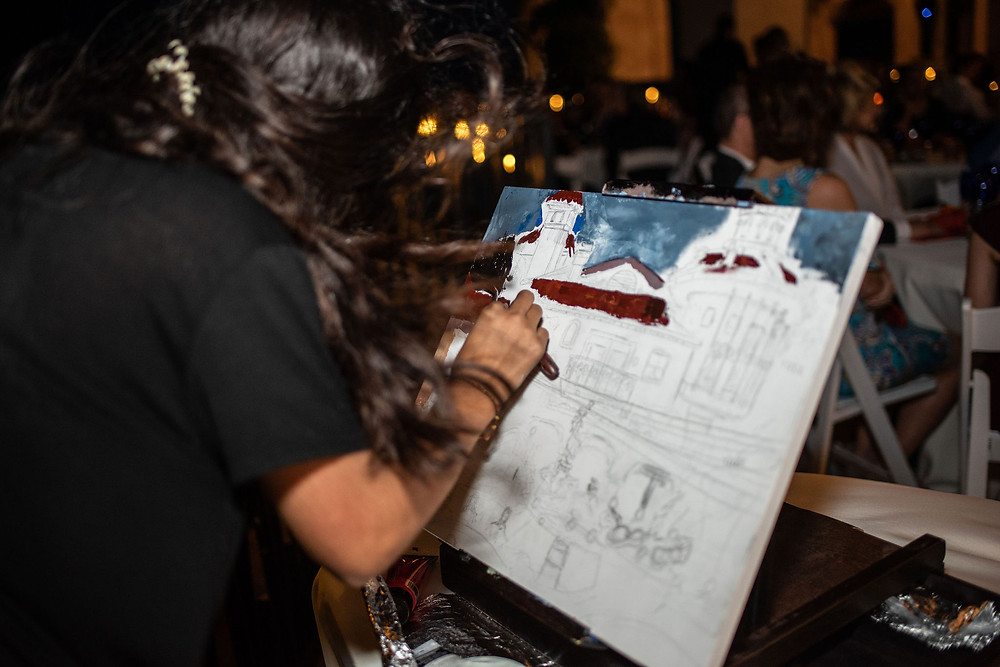 live artist paints wedding reception at villa antonia