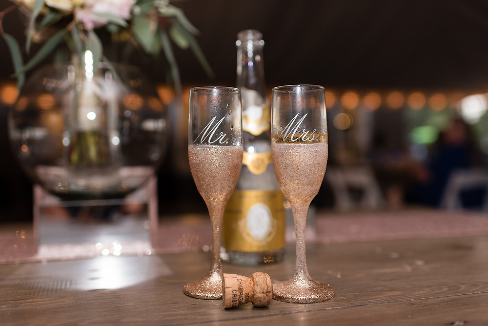 bride and groom champagne glasses at wedding