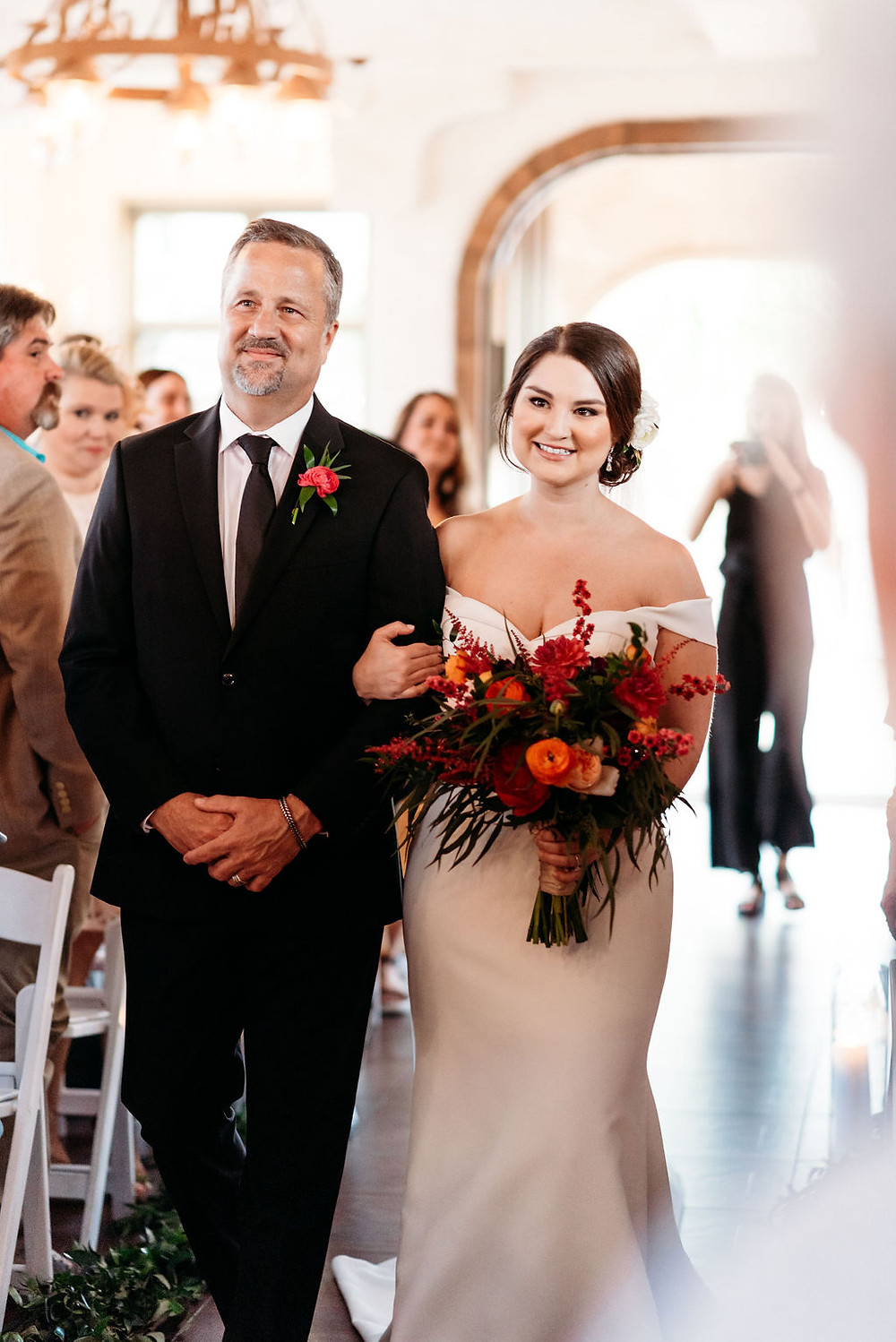 bride and dad walk down aisle for wedding ceremony at villa antonia