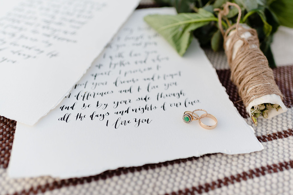 detail photo of wedding vows and wedding rings