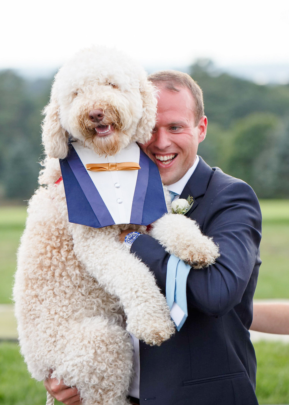 groom with dog at wedding