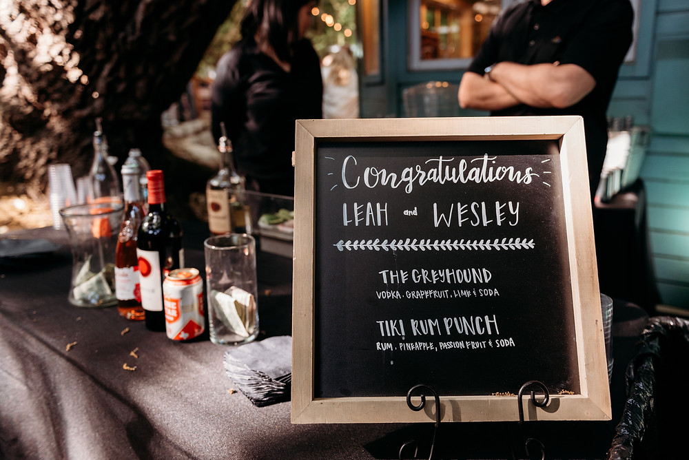 bar with personalized wedding sign congratulating the couple