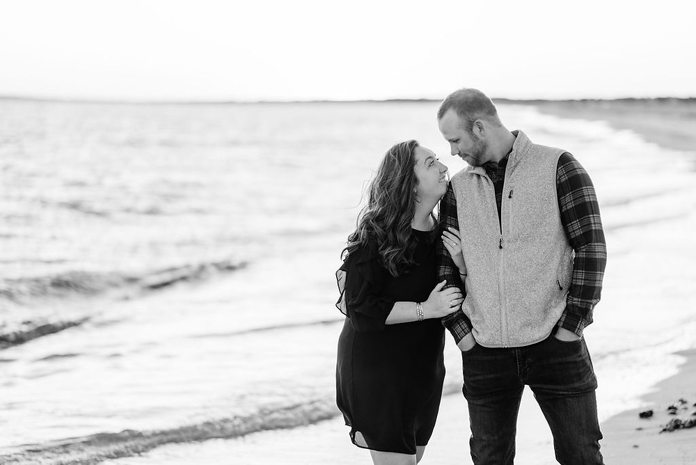 couple on beach for engagement photos at lighthouse inn in West Dennis Cape cod, MA