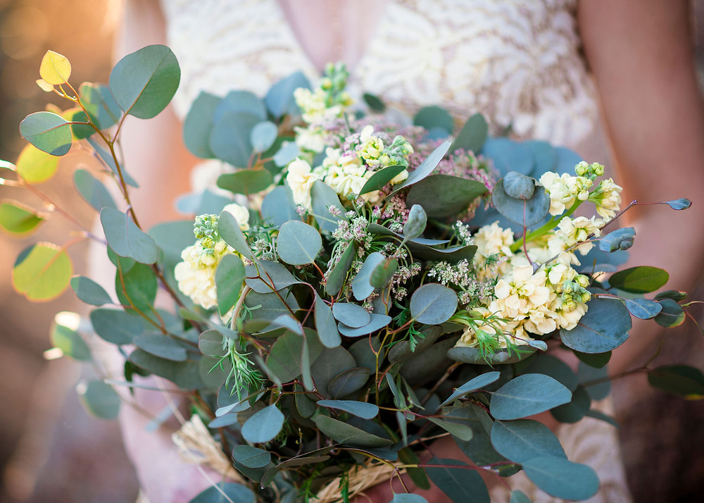 bridal bouquet of eucalyptus and white flowers. Bouquet was sourced from Central Market for a budget since it was for an elopement.