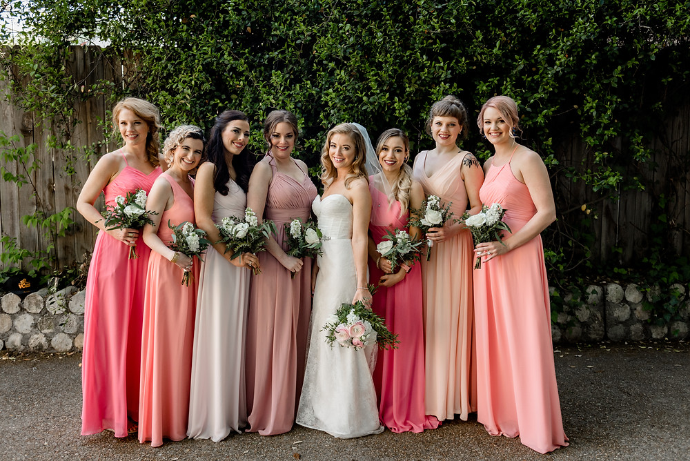 bridesmaids standing in a line smiling