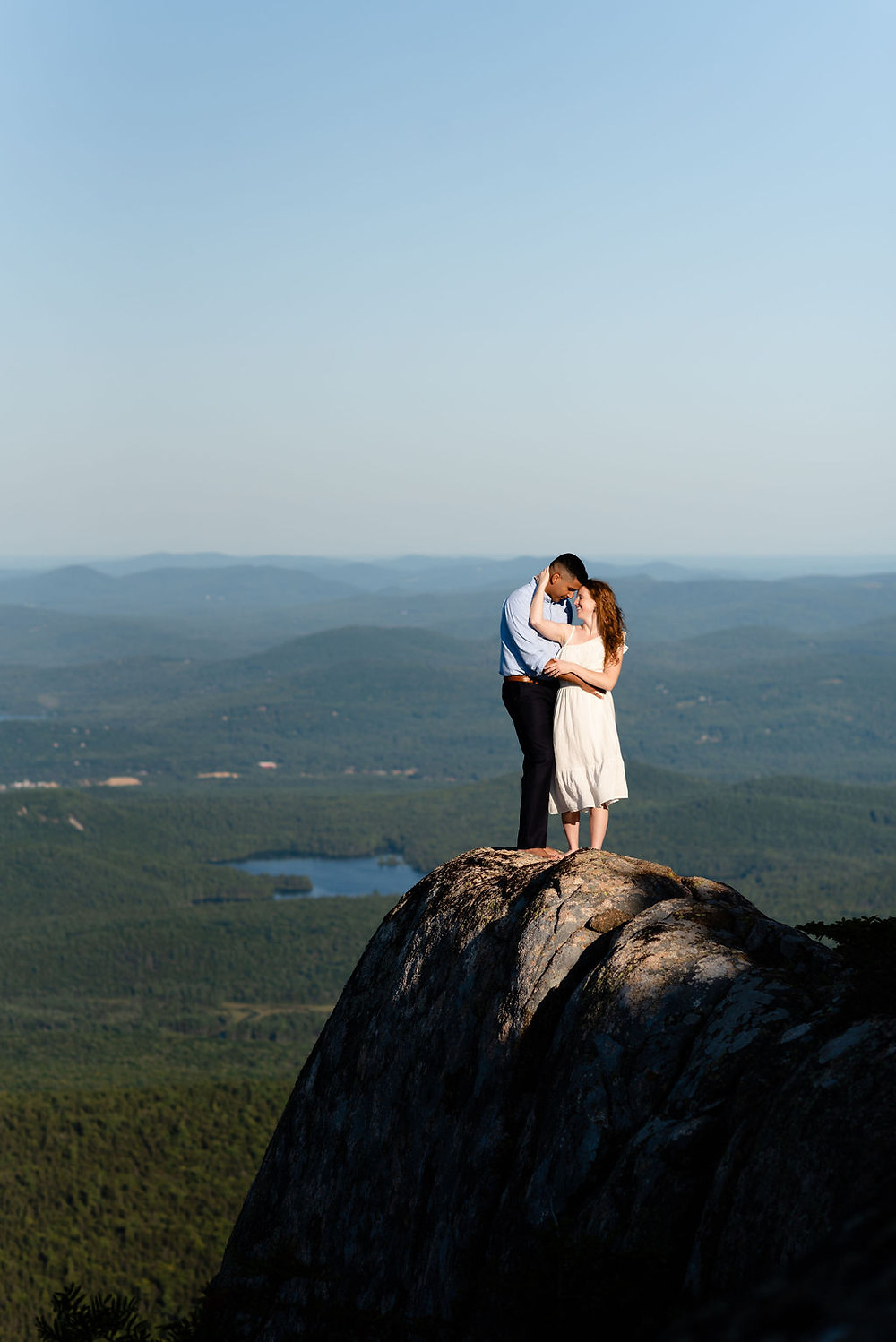 bride and groom on the summit of mount chocorua for their elopement. New Hampshire elopement photographer