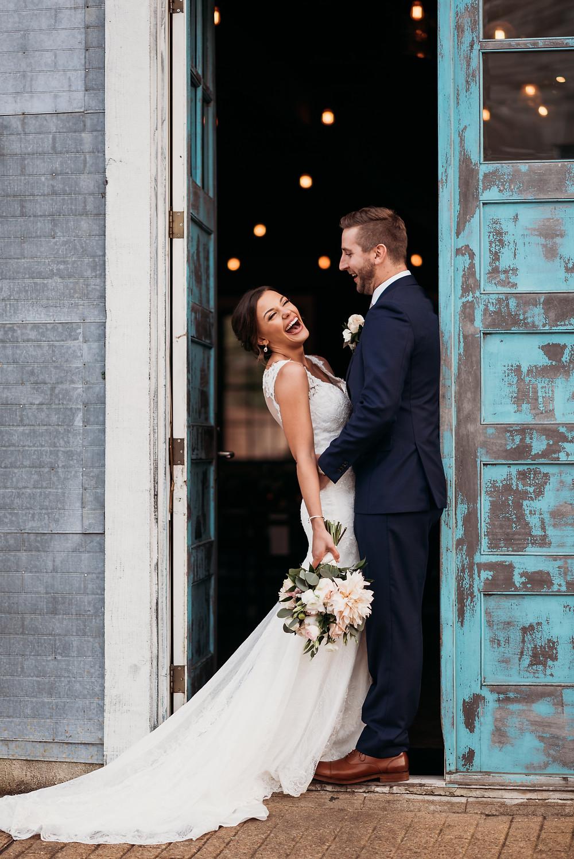 bride and groom in doorway of union on eighth blue door