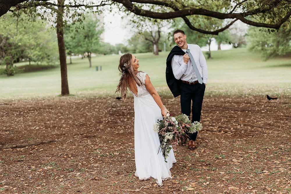 bride and groom first look. groom is animated and very happy and bride is laughing. during their austin elopement