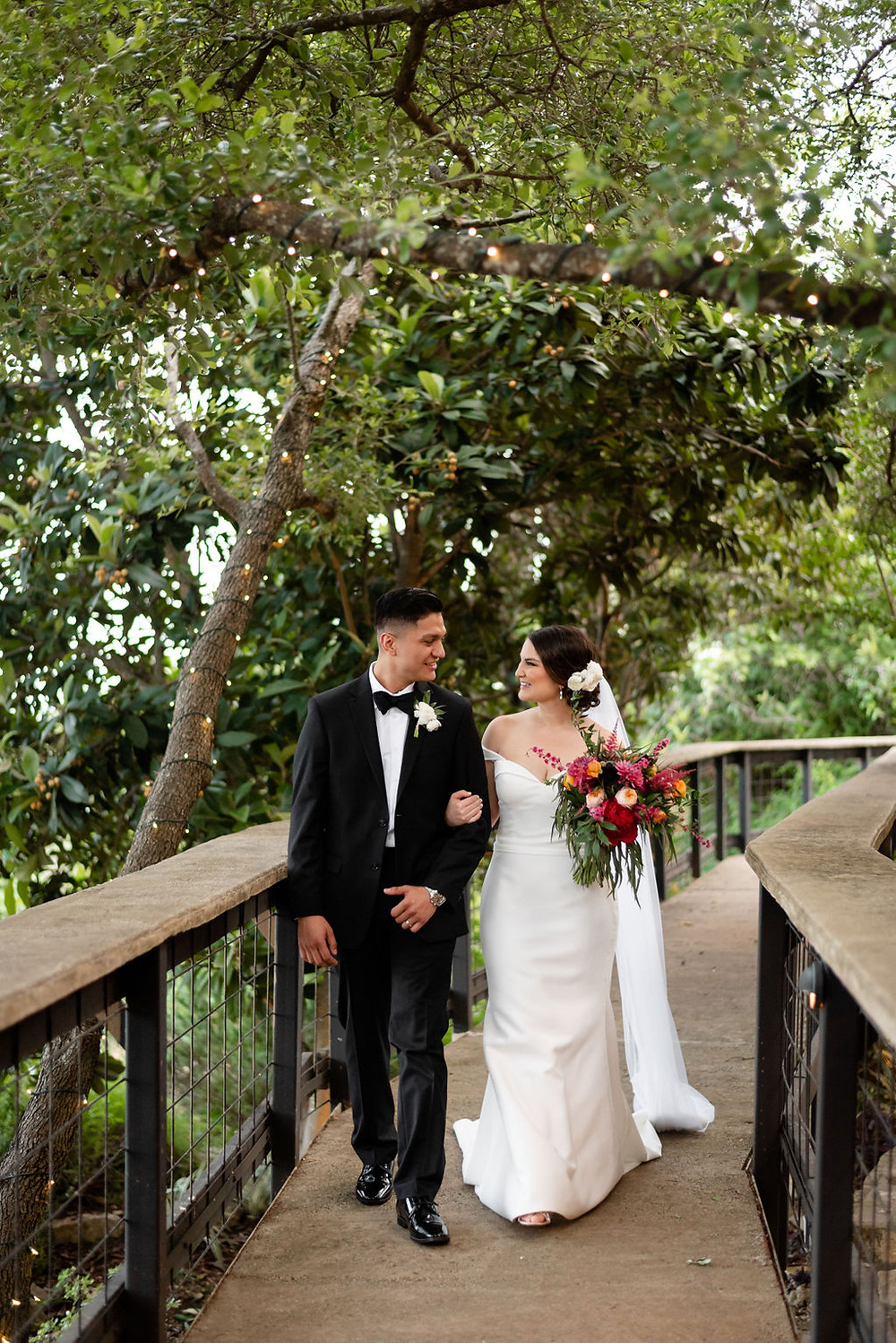 bride and groom walk through villa antonia