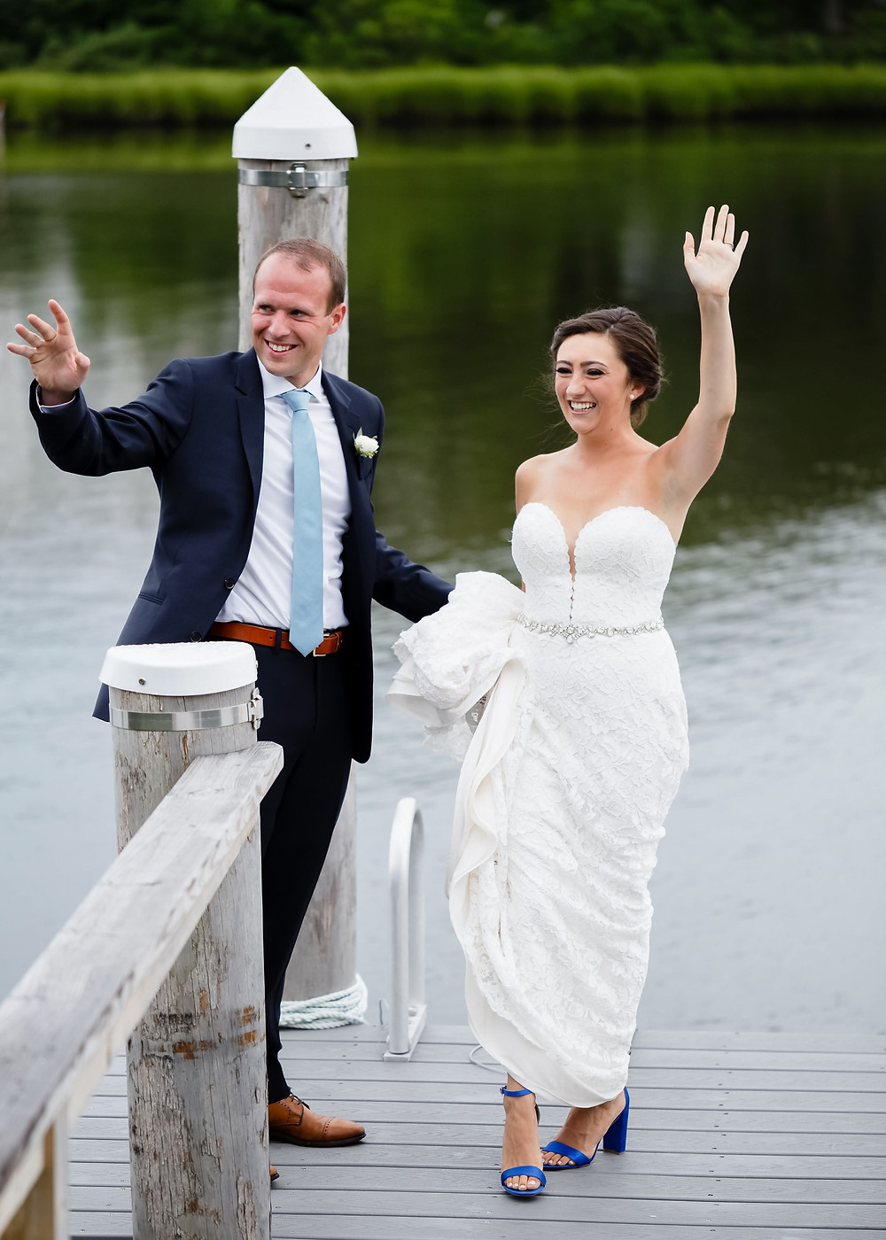 bride and groom waving during first look on dock in cape cod