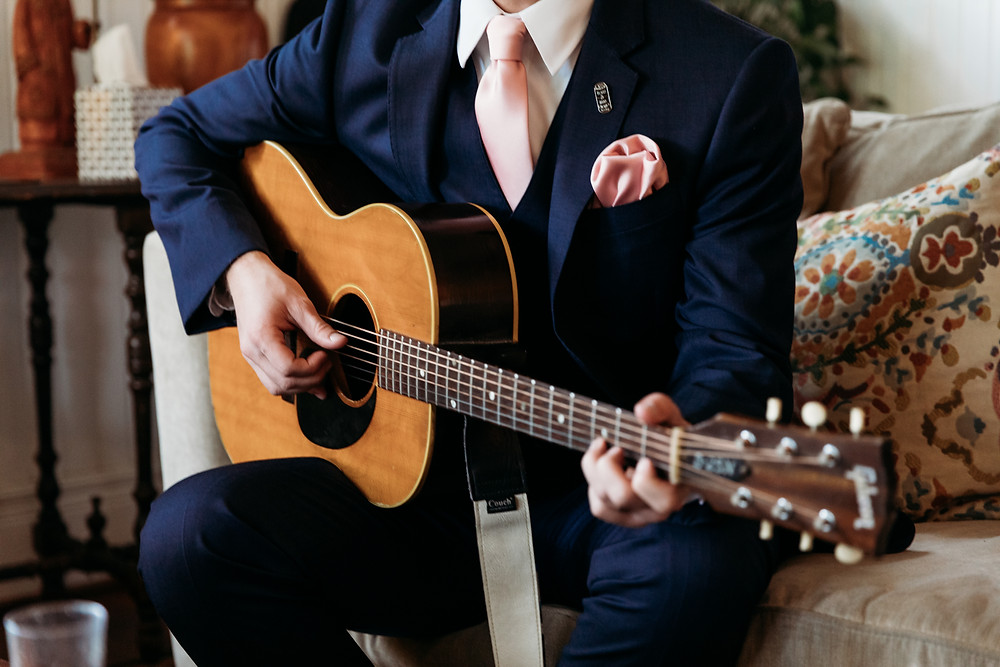 best man playing guitar