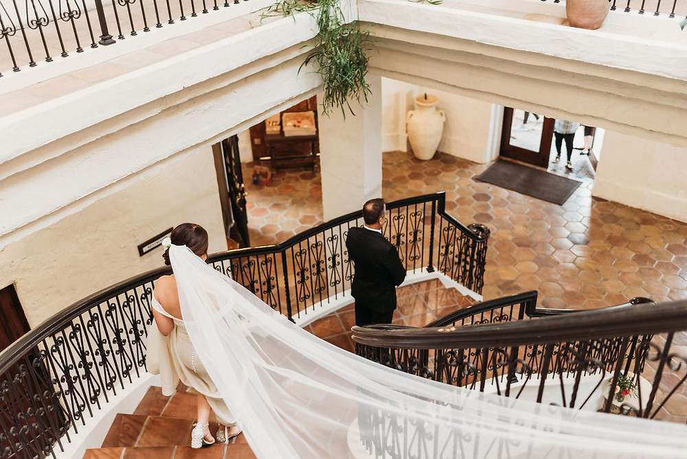 bride and father first look on the grand staircase at villa antonia