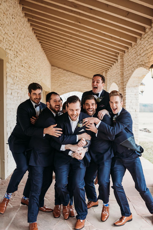 groomsmen tackling groom- wedding party poses